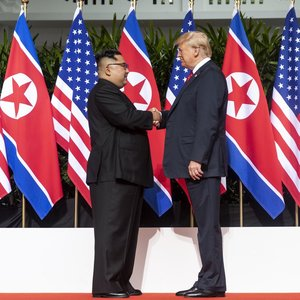 Kim and trump shaking hands at the red carpet during the dprk%e2%80%93usa singapore summit