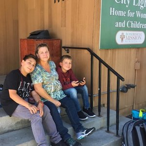 Family outside shelter